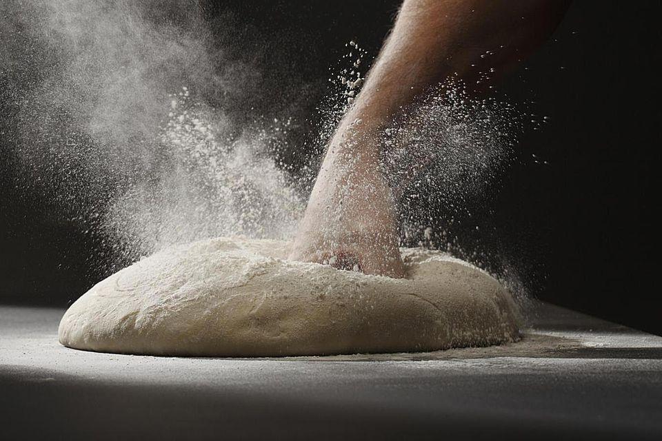 Fist Punching Down Dough