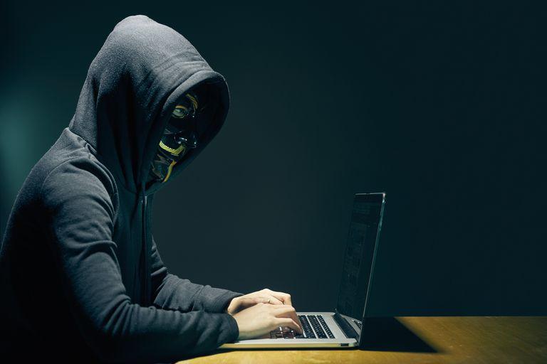 Hacker on Laptop PC