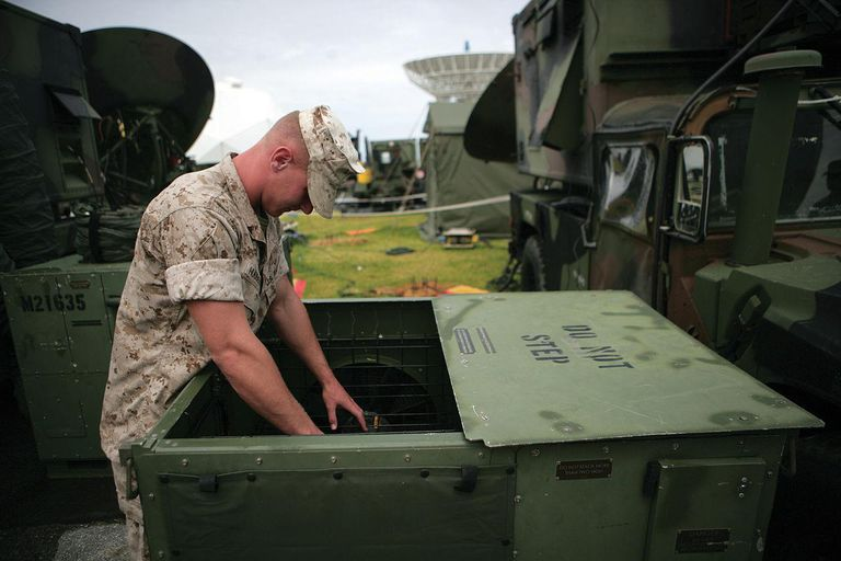 Pfc. Russell Johnston, satellite communications operator with 7th Communication Battalion, III Marine Expeditionary Force Headquarters Group, III MEF, makes sure an electronic control unit is cooling equipment at a steady rate July 22.