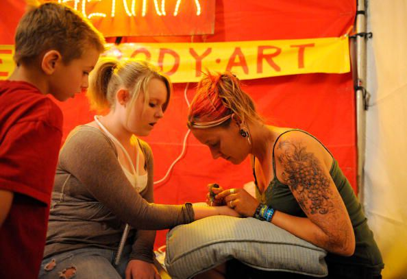 Teen Getting Henna Tattoo
