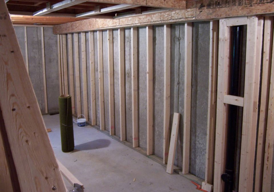 When pressure treated wood is required by code for Framing interior basement walls