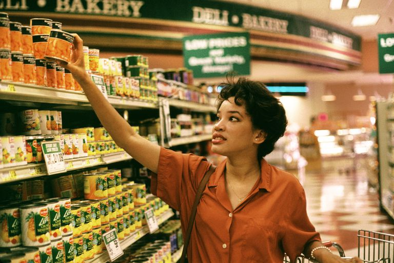 Grocery aisle of canned foods