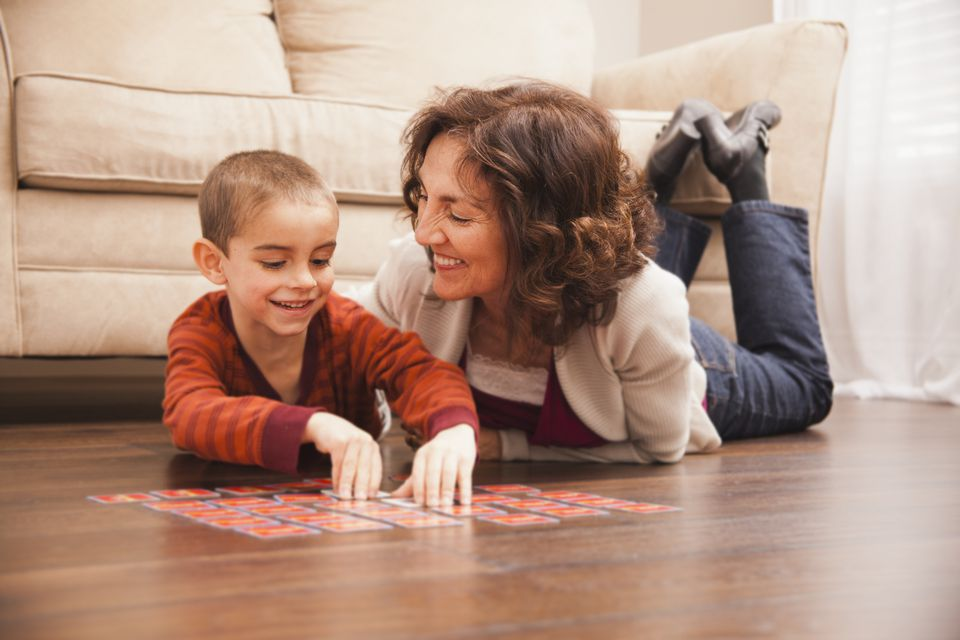 grandmother and grandson playing memory