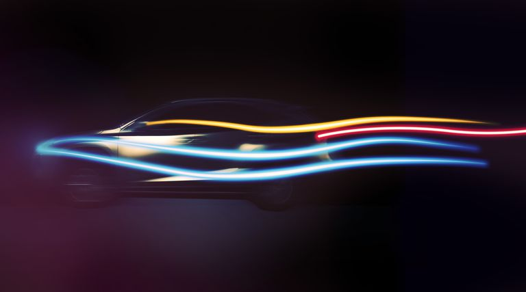 Long exposure of a beautiful SUV car with aerodynamic design in motion at night with colorful light trails in black background in a futuristic and creative picture.