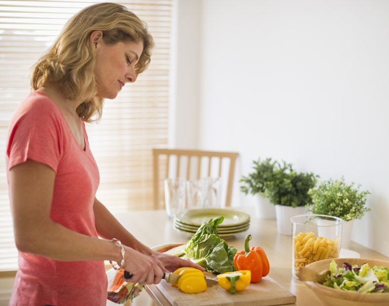 woman preparing vegetables