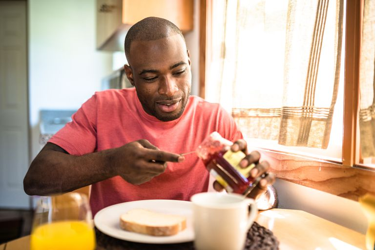 african guy doing breakfast at home african guy doing breakfast at home