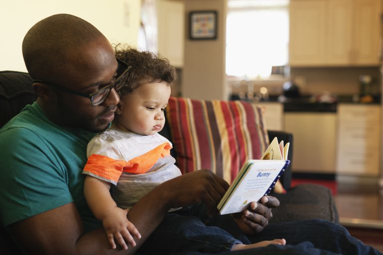 Father reading to toddler