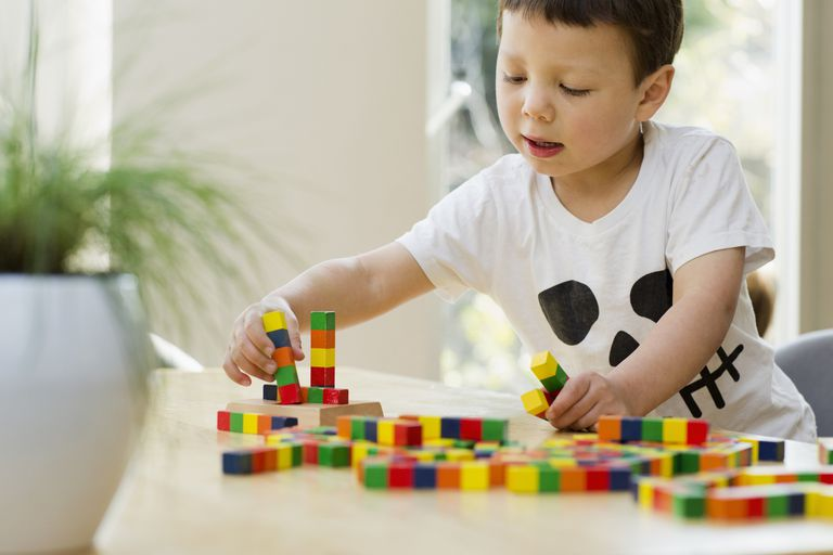 Boy playing with blocks at a table
