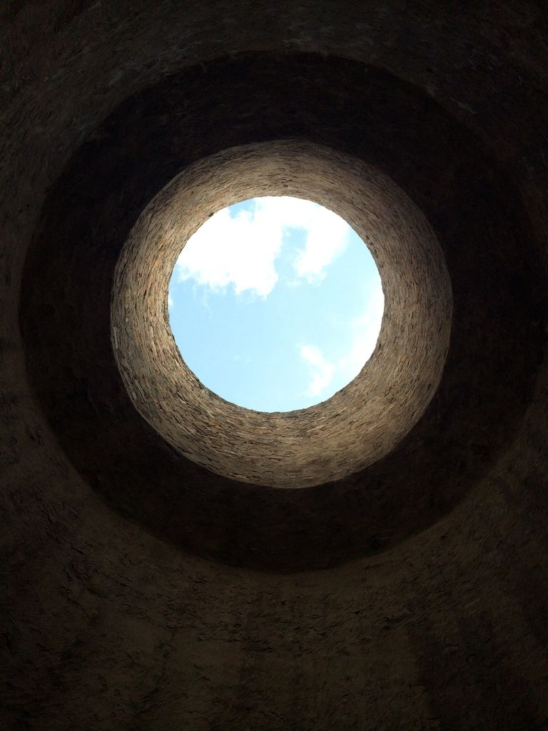 View Of Blue Sky From Bottom Of Well