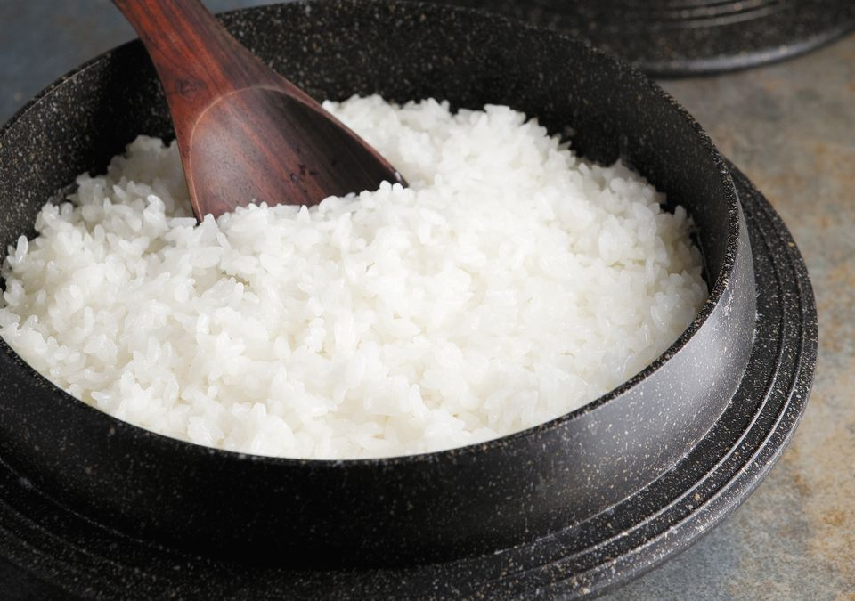 Steamed rice in an iron pot