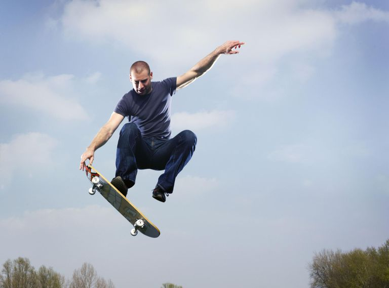 Man on skateboard in mid air