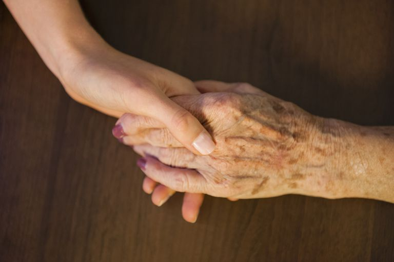 young and old woman's hands