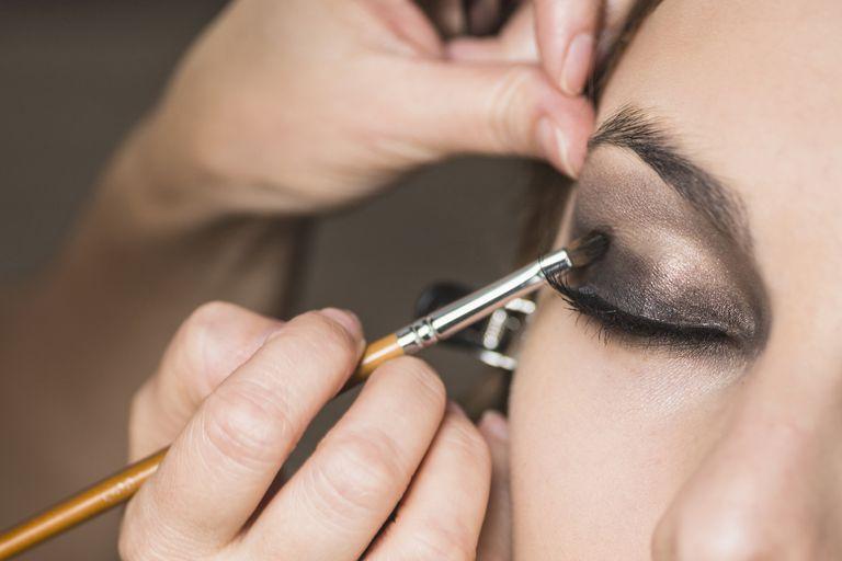 Make-up artist applying smoky eye