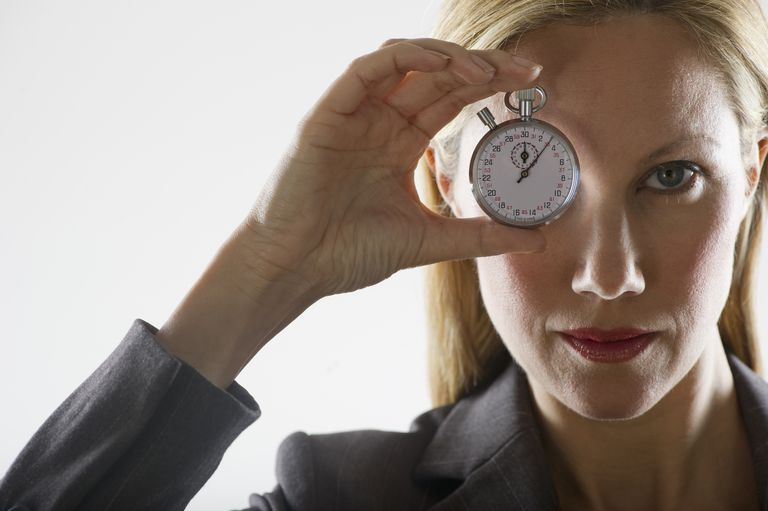 Woman Holding Stop Watch While Focusing