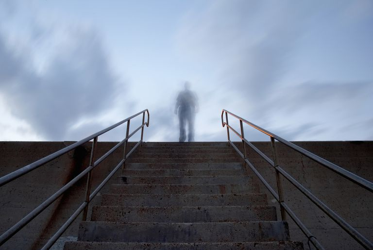 Outline of man at top of stairs, outdoors