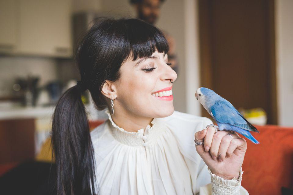 Woman holding pet bird