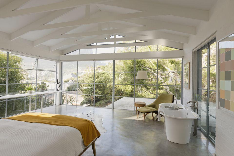 Modern luxury home showcase interior bedroom with garden view
