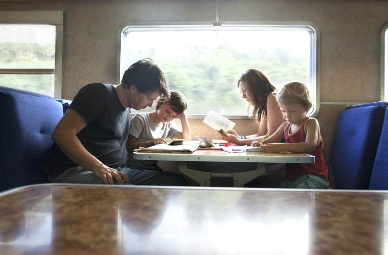 family reading on train