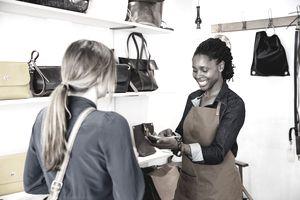 Retail sales woman helping customer.