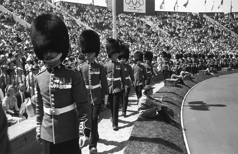 Guardsmen marching around at the 1948 Olympics.
