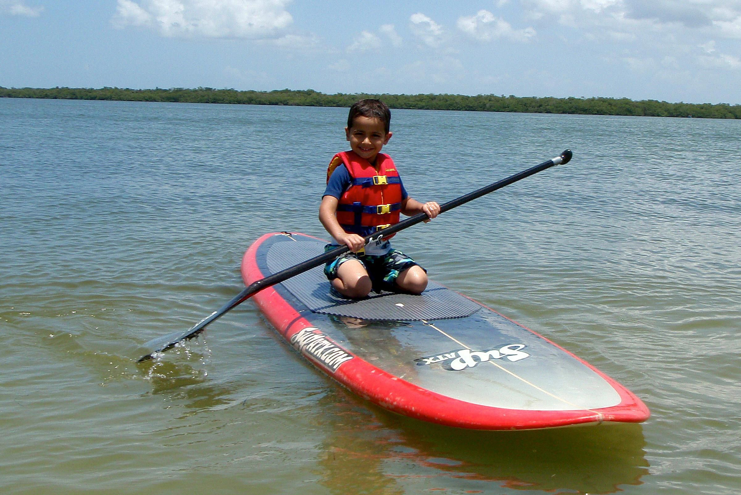 tips for paddleboarding with a child on the board