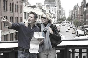 mature couple with map exploring city