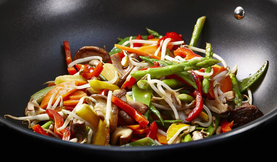 Beansprouts, peppers, shiitake mushrooms and asparagus in a wok