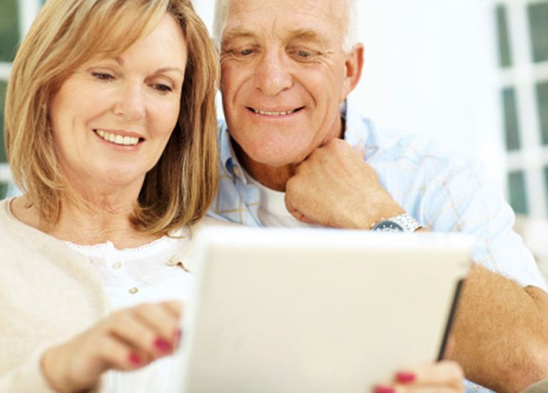Mature Couple Playing With iPad