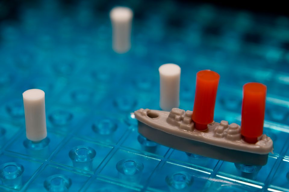 Closeup of Battleship pieces on a board