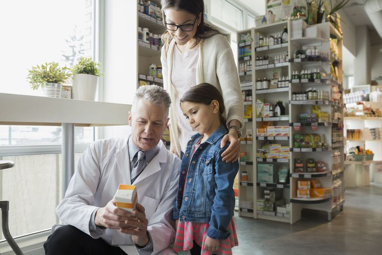 parenting style and smart consumer - mother daughter shopping with pharmacist