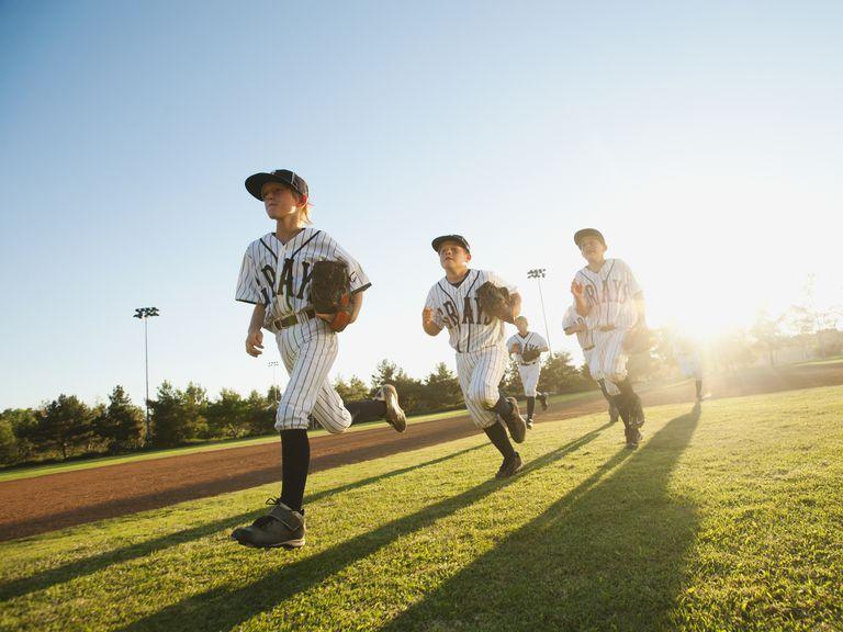 Travel team - Baseball players running on diamond