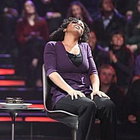 A contestant plays Face the Cookie on the game show Minute to Win It.