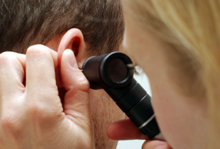 Doctor examining the ear.
