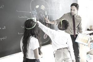 Science Teacher Explaining Diagram to Students