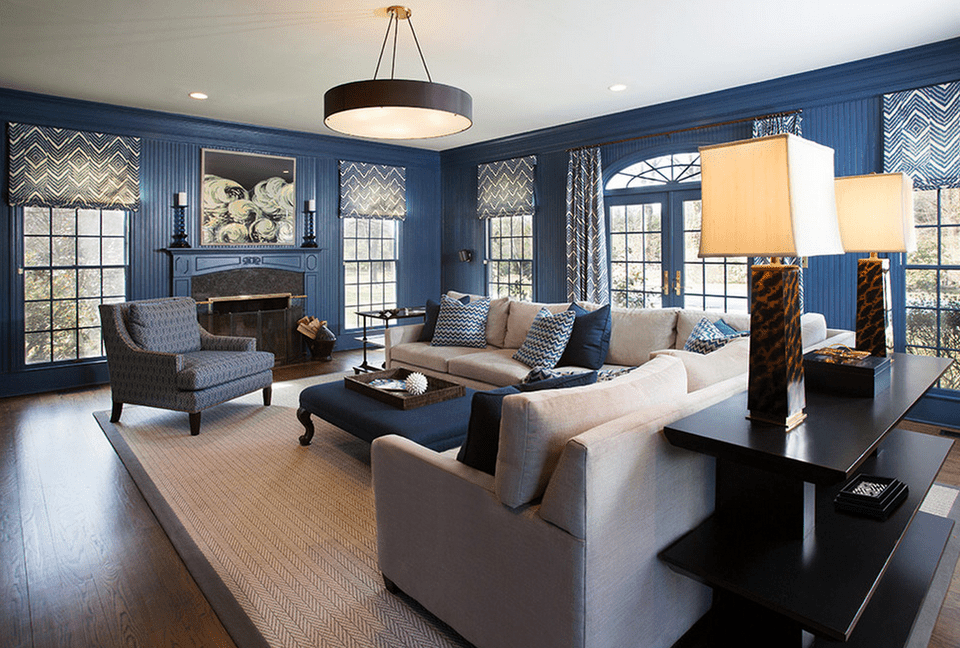transitional living room painted dark blue