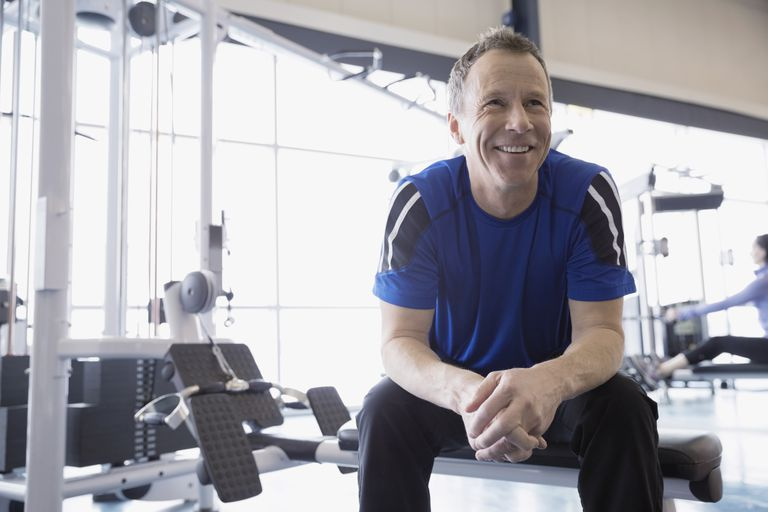 man smiling at gym