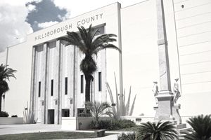 The main entrance to Hillsborough County's Courthouse in Tampa, Florida, is shown with the county's Confederate Memorial in the foreground.