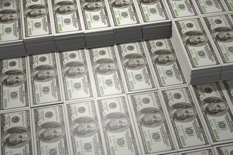 Close up of stacks of 100 dollar bills