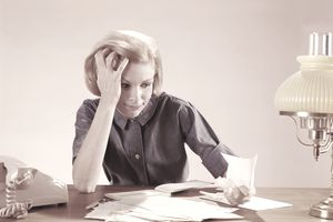 Woman figuring out AMT taxes