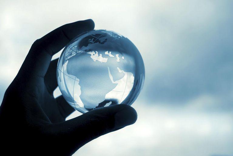 Crystal globe in hand