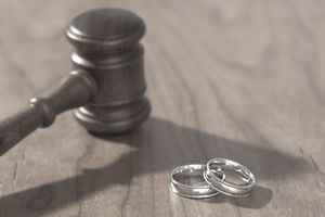 Silver wedding rings and gavel