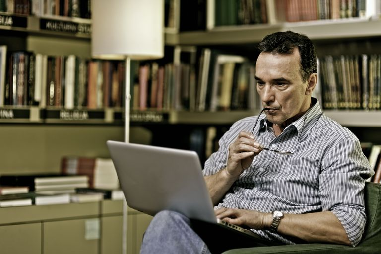 Mature adult man with laptop