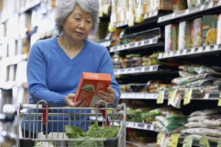 Senior woman shopping at grocery store on discount day