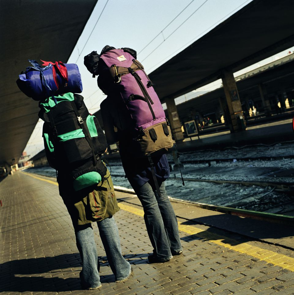 Backpackers at a train station