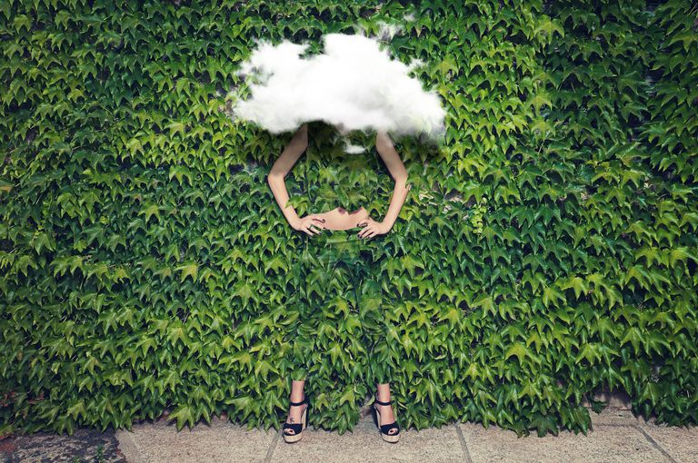 Lady disappearing in bush with cloud in front of face