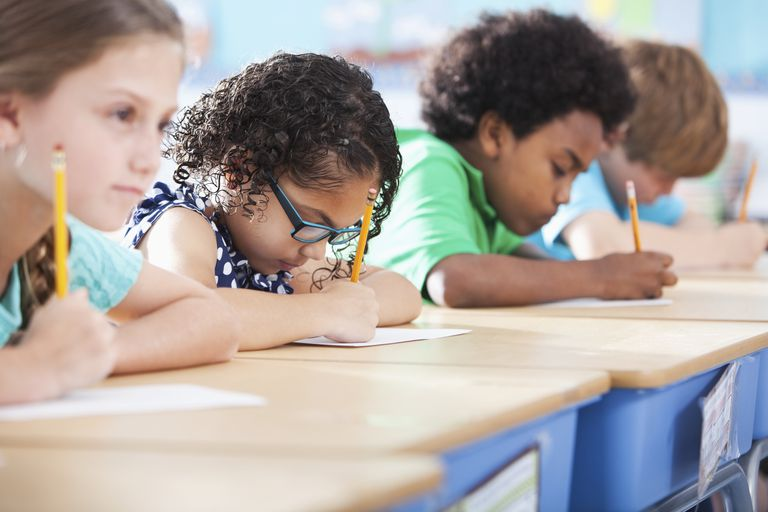Picture of elementary school children writing in class