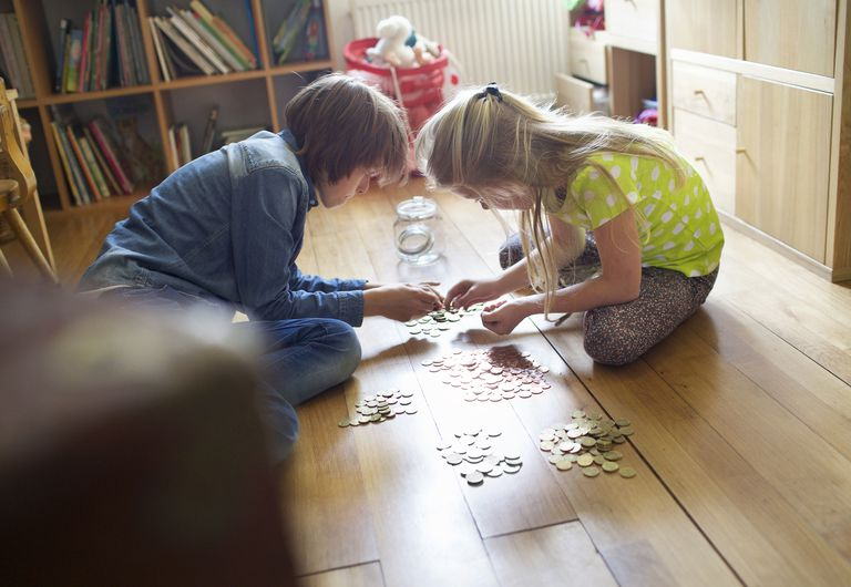 A brother and sister count their savings, representing the Protestant ethic of saving money.