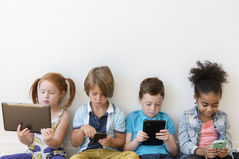 screen time - kids sitting with electronic devices ignoring each other