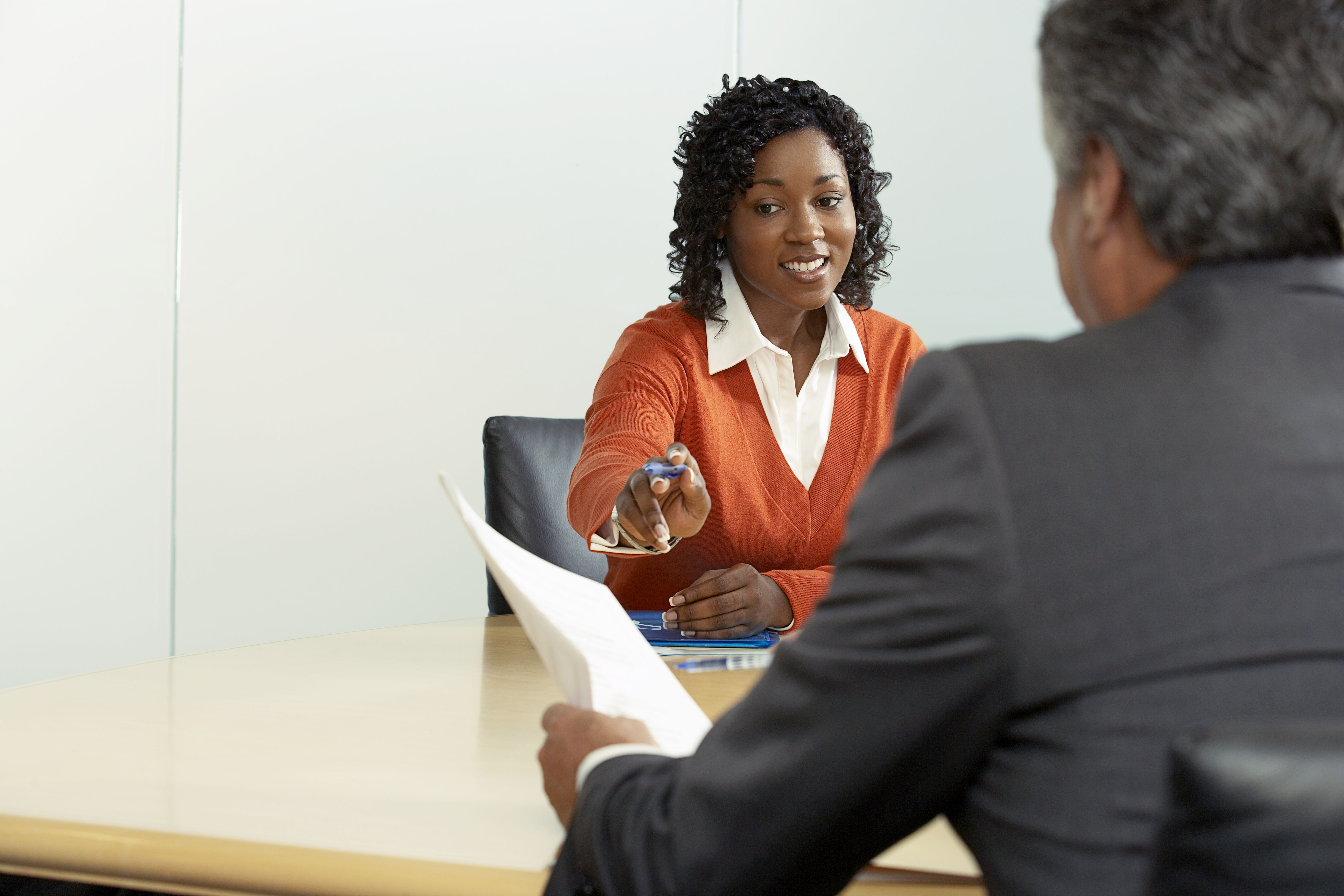What pay raise can you expect from your employer business people in a meeting to communicate and discuss the employees pay raise ccuart Images