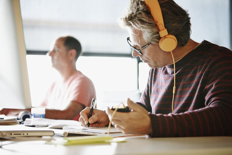 Man working at desk with headphones